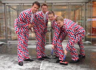 In this image provided by Loudmouth Golf, members of the Norway's Men's Olympic Curling Team from left Thomas Ulsrud, Torgor Nergard, Christoffer Svae, and Havard Vad Petersson wear their new Sochi 2014 suits as they pose for a photographer in New York Tuesday Jan. 21, 2014. So what will be the must-see moments at the Sochi Olympics? When it comes to curling, there?s no doubt what the show-stopper will be. Yes, Norway?s men?s team is back with their crazy, funky pants. And they?ll be more outrageous than ever when the players emerge for their first game at the Ice Cube. (AP Photo/Cassie Kovacevich, Loudmouth Golf)