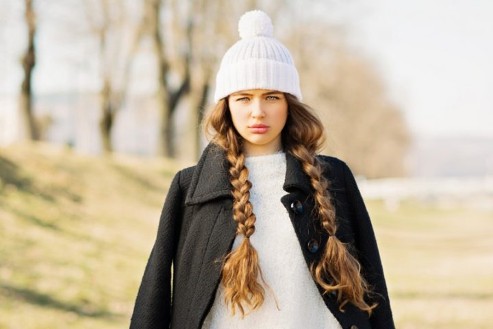 portrait-of-gorgeous-teenage-girl-with-long-blonde-braided-hair-in-winter-outfit-beautiful-young-woman-with-braids-wearing-black-coat-white-sweater-and-knitted-white-hat-805x537
